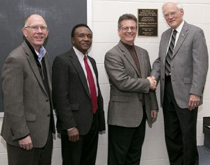 (Photo courtesy of University Relations) Congratulating Russell Coleman, right, on the dedication of the Russell Coleman Rehearsal Hall in the UCM Department of Music in the Utt Building, are, left to right, UCM President Chuck Ambrose; Gersham Nelson, dean of the College of Arts, Humanities, and Social Sciences; and Steven Moore, chair of the Department of Music.