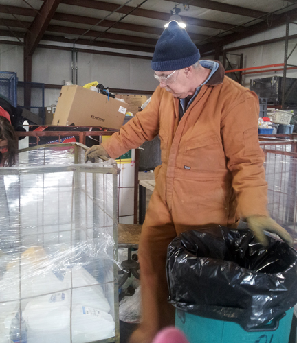 (Photo by Alexandra Lambdin) A Johnson County Sheltered Workshop employee sorts recyclable materials. The workshop now accepts glass.