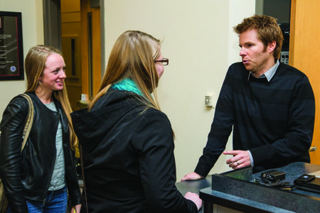 Ashley Klaty (left), and Michelle Griffith (center) talk to Alex Buono after his presentation on Monday in Ward Edwards. (Photo by ANDREW MATHER, Photo Editor)