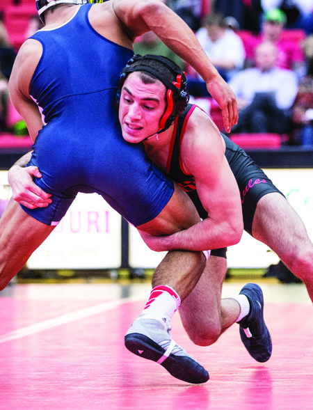 Redshirt junior Nick Viterisi wrestles during a home match. (Photo by ANDREW MATHER, Photo Editor)