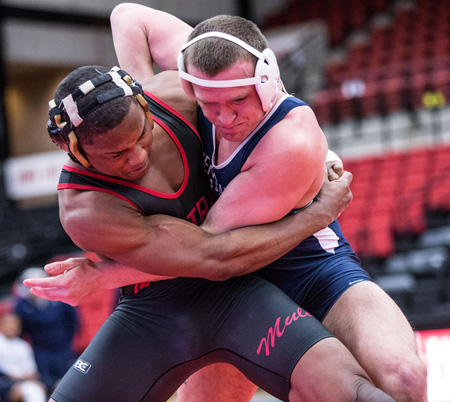 Senior Clarence Neely (left) and the Mules wrestling team will compete in the MIAA Tournament Sunday. (Photo by ANDREW MATHER, Photo Editor)