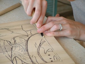 (Courtesy photo) Carolyn A. Hull crafts a relief print for her upcoming show.