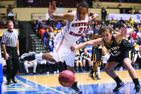 Junior Keuna Flax tries to save the ball going out of bounds during the 87-78 MIAA Tournament semifinal win over Fort Hays State Saturday. (Photo by ANDREW MATHER, Photo Editor)