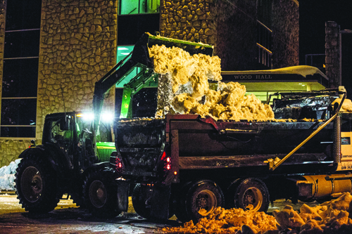Crews worked 12-hour shifts in an effort to remove snow from the UCM streets, sidewalks and parking lots so students could return to classes. (Photo by ANDREW MATHER, Photo Editor)