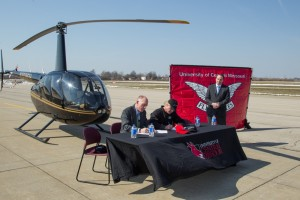 (Courtesy photo) University of Central Missouri President Charles Ambrose, left, and Johnny Rowlands, center,  president of KC Copters, signed a memorandum of understanding that will make the helicopter flight training program available to the public at UCM's Max B. Swisher Skyhaven Airport.