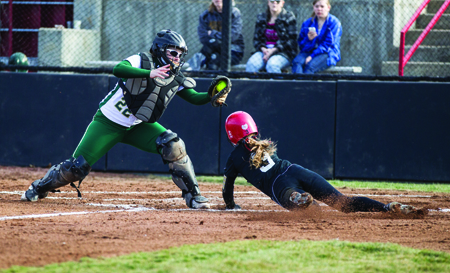 Junior Medora West slides into home plate against Missouri S&T March 13 at the South Recreation Complex. (Photo by ANDREW MATHER, Photo Editor)