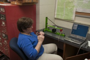 (Photo by Anna Jones) Sally Zellers discusses UCM's new seismograph.