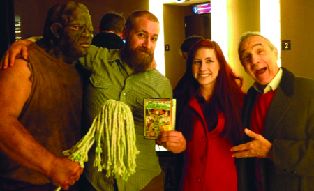 """Lloyd Kaufman (far right) poses with (far left) the Toxic Avenger, dan Paul Joyner and one of his company's """"tromettes"""" Courtney Meeker, a UCM alum, before a showing of his films at the Alamo Drafthouse in Kansas City. Kaufman and his films take a satirical stab at society with over-the-top gore, grit and full frontal nudity. (Photo submitted)"""
