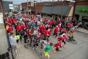 (Photos courtesy Andrew Mather, digitalBURG) Runners bolt off the starting line on Saturday, April 6 for the Blaine Whitworth Memorial 5K.