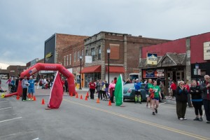 The finish line stands in front of Bodie's and Blaine's Bar & Grille.