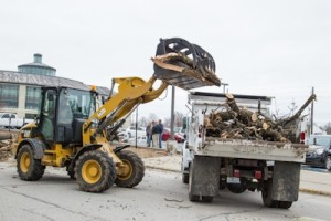 Heavy equipment is brought in to remove scattered debris.