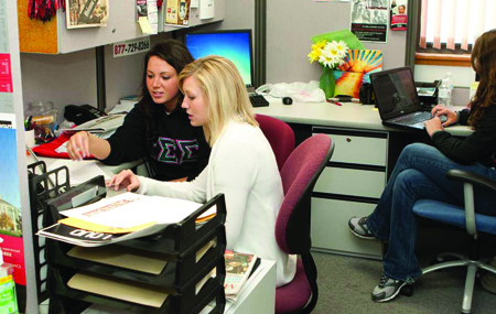 Sadie Hicks, Dani Myers and Kellyn Baysinger work in the Innovative PR office for their client Earth Day 365. The office is a part of University Relations. (Photo by NICHOLAS HALL, for The Muleskinner)