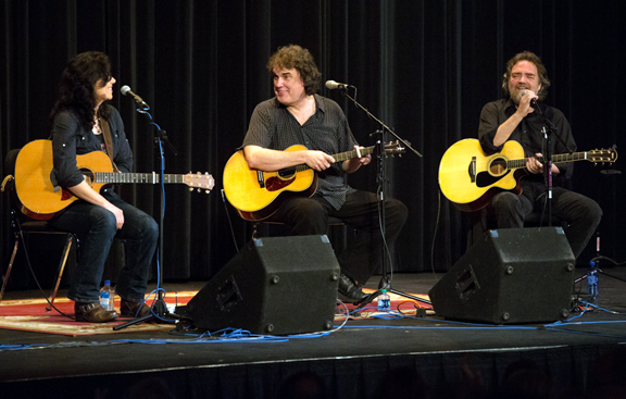 From left, Maia Sharp, Craig Carothers and Randy Sharp share a light moment on stage during their performance Friday. The have contributed to some of pop, rock and country's biggest hits by stars like Dolly Parton, The Oak Ridge Boys, Reba McEntire, The Dixie Chicks, Peter Paul and Mary, Trisha Yearwood, and Bonnie Raitt.