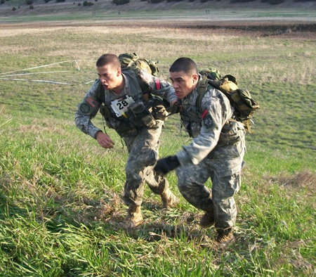 Cadets Ian Powers and Robert Smith participate in a challenge. (Photo by LIZ WOOD, for The Muleskinner)