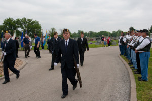 (Photos by Taz Hall, digitalBURG) Members of the American Legion, along with representatives from all branches of the military, gather at Sunset Hill Cemetery on Colburn Road Monday morning for Memorial Day services. The gathering was lead by Alex Slocum, commander of the Warrensburg American Legion; Bryan Lee, commander of VFW; and Keith Lawrence, who lead the group in a prayer as American Legion chaplin.