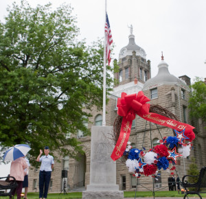 Members of the Warrensburg American Legion gather at the Johnson County Courthouse on Holden Street for a reading of the names of fallen soldiers from the stone marker. The ceremony was relocated to the American Legion building on Young Street due to inclement weather.