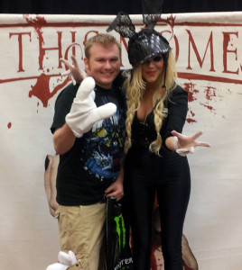 Andy Lyons and In This Moment lead singer Maria Brink pose for a photo at the show.