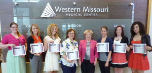 Sharon Franklin, WMMC Auxiliary board president, fifth from left, poses for a photo with the 2013 WMMC Auxiliary Health Care Career $500 Scholarship winners. The students are, from left, Rachel Clancy, of Warrensburg; Callie Hicks, of Whiteman AFB; Storm Simons, of Merriam, Kan.; Renee Kozee, of Holden; Jackie Discher, of Kansas City, Mo.; Gabriella Cavuoti, of Warrensburg; and Jorglynne Shepard, of Lee's Summit.
