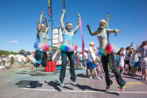 From left, color runners Liza Scharhag, a nanny from Olathe, Kan.; Missy Wilkinson Zadow, a polysomnographic technologist from Overland Park, Kan.; and Lara McCracken, a legal assistant from Kansas City, Mo., jump in celebration of a successful and fun time at The Color Run.