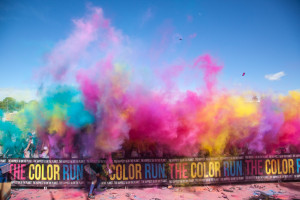 During the final color throw of the day, the air is filled with every color of the rainbow as hundreds of people throw fistfuls of color into the air. Color throws take place every 10 minutes at the color celebration at the end of the race.