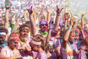(Photos by Andrew Mather, digitalBURG) The runners, plastered in a rainbow of colors, dance and cheer during the color celebration at the main stage.