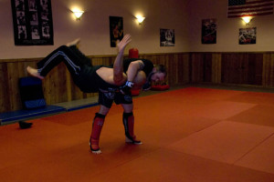(Photos by Kaitlin Becker) Denton Matheny, 24, does an MMA move called a hip throw to toss his father, Billy, 47, to the mat during their practice at Warrior Jujitsu Monday, June 3. The facility is located at 121 E. Pine St. in Warrensburg. Denton trains to fight in MMA tournaments.