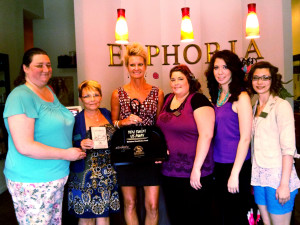 """(Courtesy photo) From left, Stephanie Yates, Diane Bradley, Kitty Sandberg (Euphoria Salon & Day Spa owner), Misty Schuster, Hillary Rein and Jennifer Costa pose for a photo after Warrensburg Main Street Inc. presented the spa with the """"You Swept us Away"""" design award Monday. The award is given to business owners who keep the area around its building free of litter, maintain a clean outside appearance through renovation and keep its store windows, and window frames and door frames clean."""