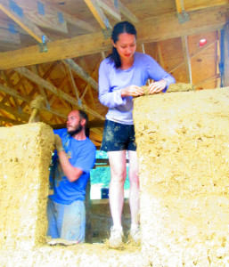 (Photo by Kelsey Harmon) Mike and Andrea Reinhardt work on the walls of their house. They hope to be able to move in by the end of fall.