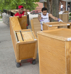 Mules football players Tevin Teamer, left, and Diaron Rhodes help load old furniture from South Yeater Hall on a truck to be shipped to an orphanage in Afghanistan.