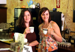 Photo by Kevin Lyon/digitalBURG Julie Kendall and Shelby Smith take a break as they close down Cafe Blackadder on Tuesday.