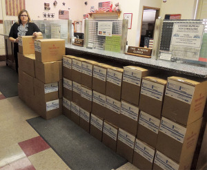 By MEGAN RYBA County Collector Ruthane Small stands by numerous boxes containing blank statements that she and her staff will use for printing Johnson County property tax bills.