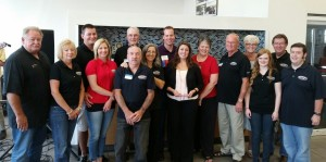 Warrensburg Collision was recently named the Warrensburg Chamber of Commerce's Business of the Year. Pictured, from left, is Steve Brewington, Beverly Brewington, Nick Novotney, Jessica Novotney, Marion Woods, Guy Reynolds, Ronnie Reynolds, Casey Lund, Jessica Lund, Penny Lund, Charlie Lund, Sandy Jennings, Ellen Becker, Ray Jennings and Josh Blaize.