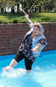 PHOTO BY BETHANY SHERROW / ASSISTANT NEWS EDITOR Heather Mynatt splashes through the fountain near Selmo Park, showing off her quirky personality.