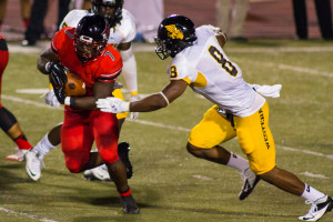 Running back Markel Smith eludes Missouri Western line backer Darrian Bass on his way to positive yards.