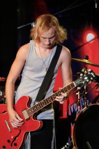 PHOTOS BY RYAN KOCH / PHOTOGRAPHER Eddy Davis, a 16-year-old musician, opens Friday night's concert.