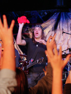 Christian O'Connor pauses between songs to throw a few T-shirts to students.