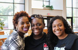 PHOTOS BY BETHANY SHERROW / ASSISTANT NEWS EDITOR From left, Underdogs Vice President Raven Alade, Mentor Keyontae Richardson and President Lauren Newsome share a moment atrium in the Elliott Student Union.