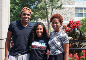 Mentor Coordinator Ramon Henderson, President Lauren Newsome and Vice President Raven Alade pause for a photo outside of the Elliott Student Union.