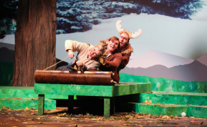 "PHOTOS BY BETHANY SHERROW / ASSISTANT NEWS EDITOR From left, Hannah Michaelree, Zach Craft and Austin Hook play animal characters who sled down a mountain on their way to America from Canada. The play ""Gustav: The Goose Who Wouldn't Fly"" by Matt Fotis premiered Friday evening in the Highlander Theatre."