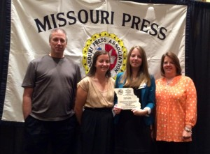 PHOTO SUBMITTED BY NICOLE COOKE Nicole Cooke, third from left, poses with her family during an awards luncheon Saturday with a plaque after receiving the 2015 William E. James Outstanding Young Journalist of the Year award at the Missouri Press Association Convention in Columbia, Missouri. From left, her family is father, Randy; younger sister, Laura; and mother, Ann.