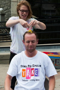 Meagan Fitzgerald, a junior dietetics major, cracks an egg on Nick Zahner's head, all to raise money for a self-defense course.