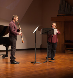 "Lee Hartman, left, and Sheri Mattson perform a duet of ""Otono en Buenos"" using an English horn and an oboe."