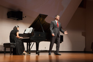 "Singing tenor for ""Lunge de lei . . . De'miei boleti spirit,"" Jacob Sentgeorge's voice echoes and bounces off the walls. Miyeon Choi accompanies Sentgeorge on stage performing on the piano."
