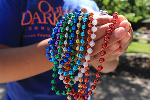 """Multi-colored """"honor beads"""" are used to signify specific loss and struggle of an individual person."""