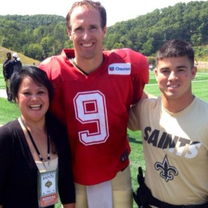 PHOTO VIA MATTHEW GOOD'S INSTAGRAM ACCOUNT From left, Norie Good, Drew Brees and Matthew Good pose for a photo at the New Orleans Saints training camp. Matthew interned with the Saints this summer as an athletic trainer.