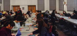 PHOTO BY MARIE NABORS / PHOTOGRAPHER Students gather around tables to practice their origami skills in Union 236 on Saturday for the Spotlight event All Things Japanese.