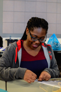 PHOTO BY MARIE NABORS / PHOTOGRAPHER Josephine Brooks, freshman illustration major, enjoys taking a crack at making a fan during the origami section of All Things Japanese event at the Union on Saturday.