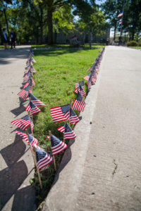 American flags line the quadrangle at the University of Central Missouri before the Patriot Day 9/11 Remembrance Ceremony on September 11, 2015. A flag was placed for every person who lost their lives in the 2001 terrorist attacks in New York City. (Photo by Samantha J. Whitehead)