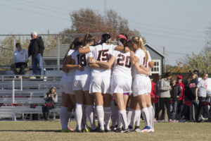 PHOT BY STEVEN SPEARS/MANAGING EDITOR The JEnnies soccer team hudles up before taking of the University of Central Oklahoma Brochos Sunday, Nov. 13, at the South Recreational Complex. The Jens earned their spot on the Central Region Championship after beating UCO 2-1.