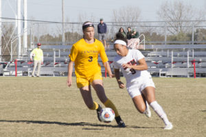 PHOTO BY STEVEN SPEARS/MANAGING EDITOR Redshirt sophomore Jada Scott (9) had five shots and one goal in the game against the Bronchos.